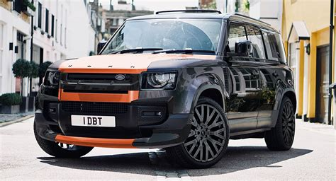 Would You Drive Around In A Black And Orange Land Rover